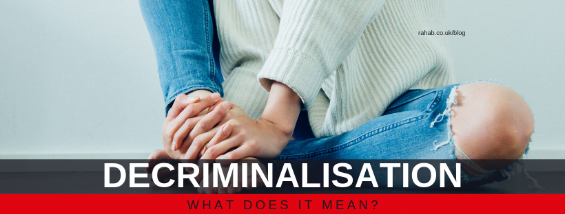 "Blog header image of a woman sat on the floor with text on which says ""Decriminalisation: What does it mean?"""