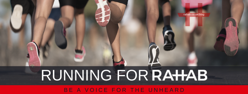 "Blog header image of people running with text on which says ""Running For Rahab"""